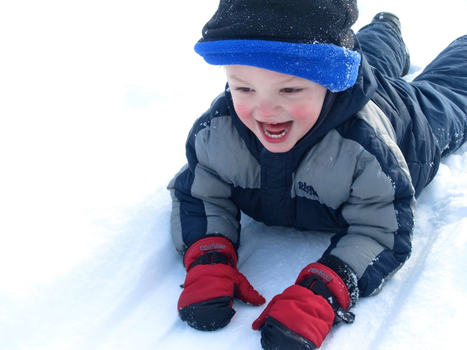 grandson playing in the snow