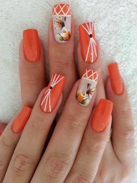 uñas pintadas de naranja con diseños