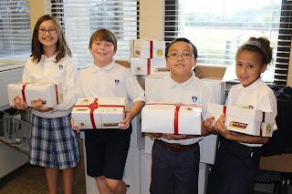 Montgomery Catholic Preparatory School Students' Collect BOXES OF JOY! 1
