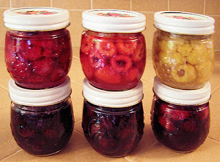 6 jars of honey-preserved berries