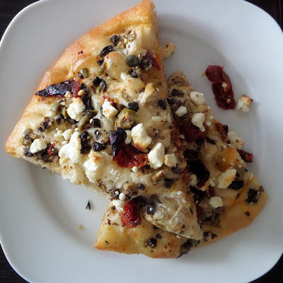Focaccia Pizza:  An Italian flat bread made with a wet dough, shaped into a pizza, and topped with tapenade, sun-dried tomatoes, and feta cheese (or toppings of your choosing).