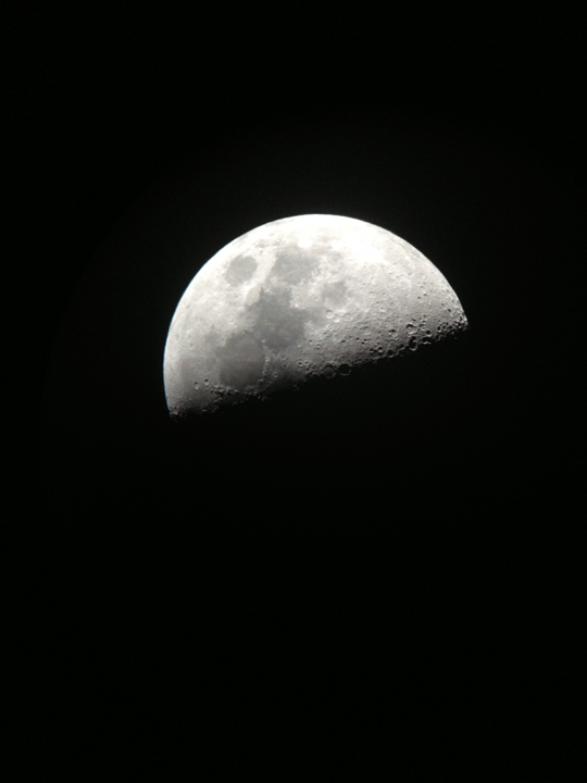 moon through a telescope on iphone