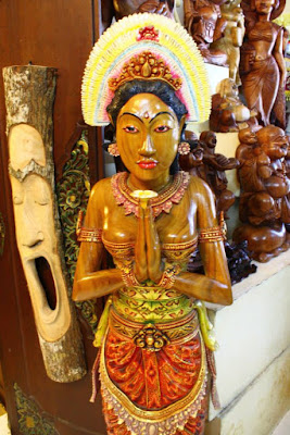 Wooden statue of traditional Balinese dancer Ubud Bali