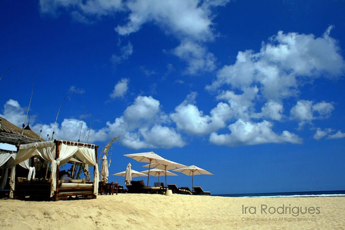 bali beach with blue skies at karma kandara resort