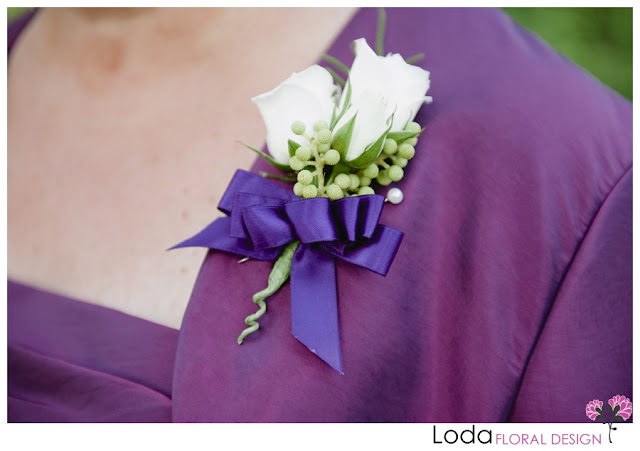 white and purple corsage