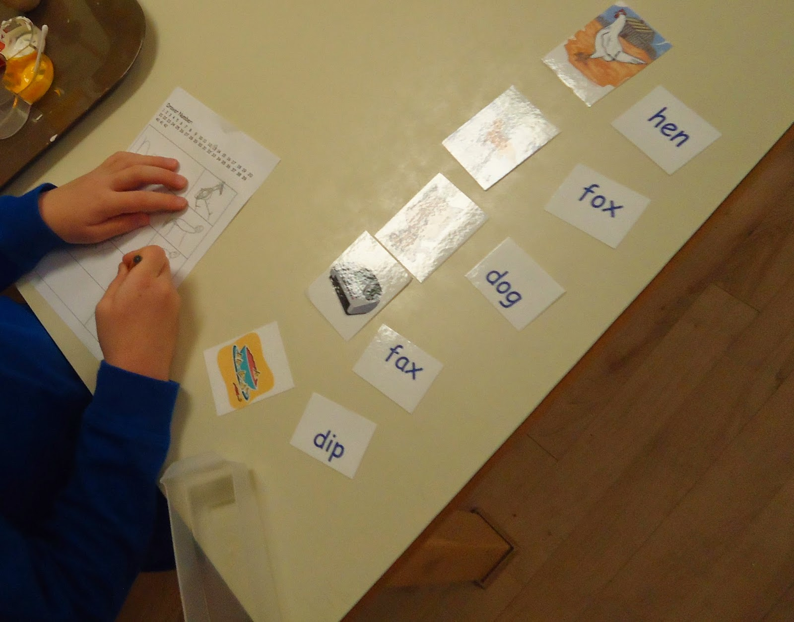 Reading Practice And Recording Words With Pictures On Paper