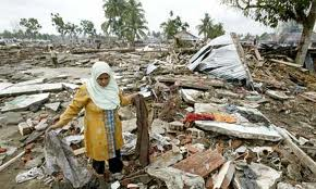 an Indonesian village being flattened after the 2004 earthquake & tsunami