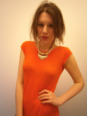 A large photo of me wearing Zara neon orange