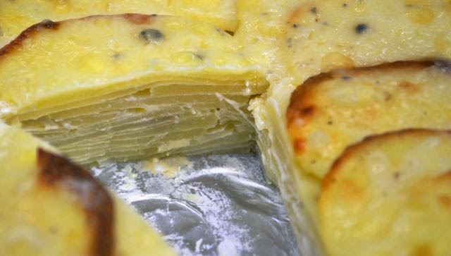 Showing layers of cooked potatoes