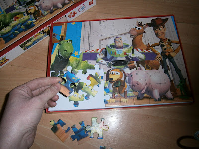 handsized pieces to help children complete the puzzle of favourite toy story characters
