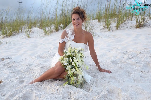 bridal portrait in front of the dunes at St. Andrew's State Park