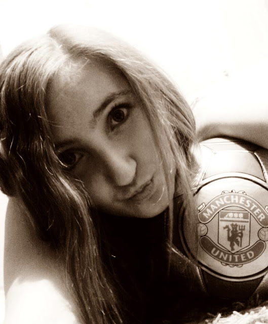 Dinaa with a Manchester United ball