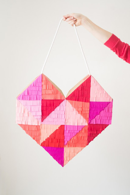 http://www.thisheartofmineblog.com/2016/01/27/bright-colorful-fringe-filled-geometric-heart-diy/
