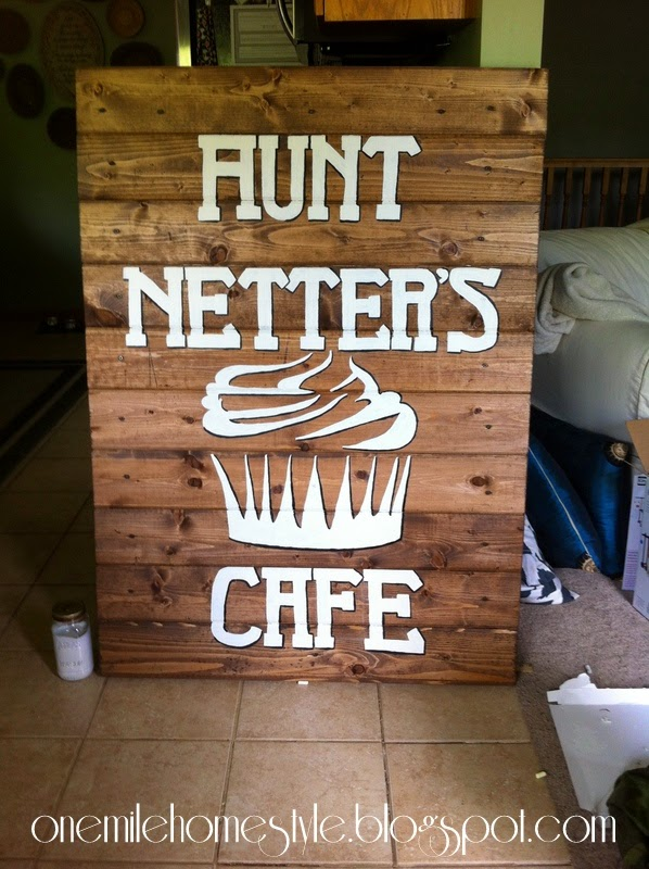 Outdoor wooden sign with lettering and logo - Aunt Netters Cafe