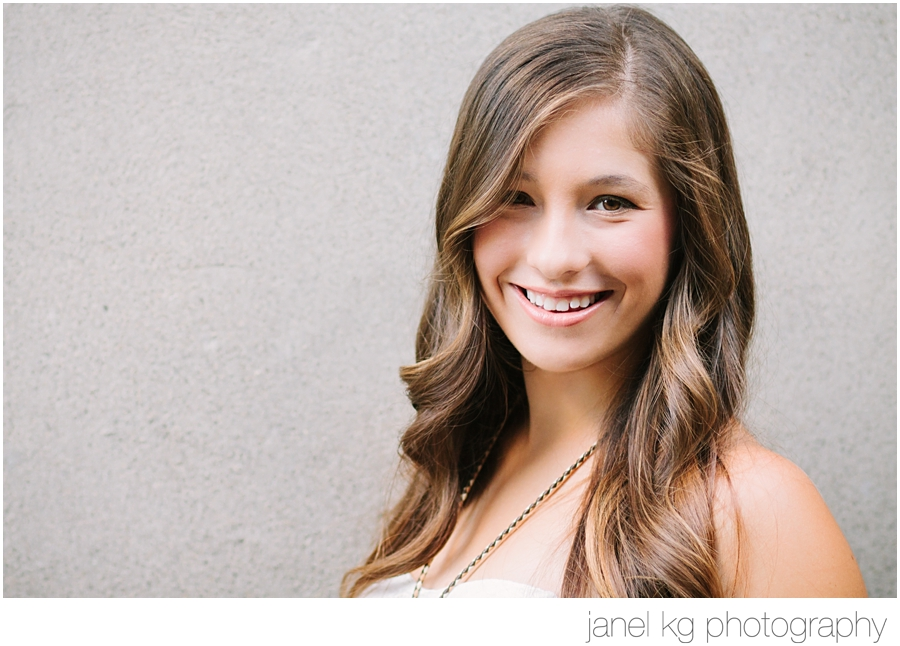 Elizabeth's gorgeous smile during her downtown Sacramento senior portrait shoot with Janel KG Photography