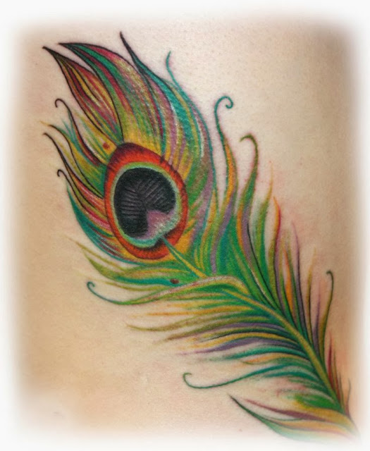 Very beautiful Peacock feather tattoos