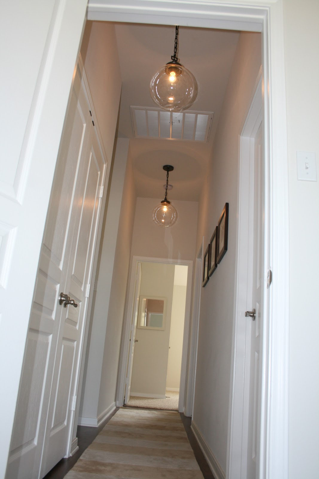 Narrow Foyer Lighting : Keeping up with the joneses quick update