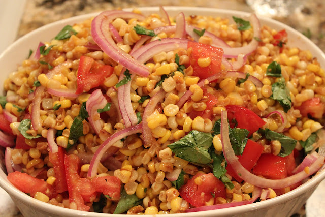 Corn salad with basil, tomatoes, and red onion