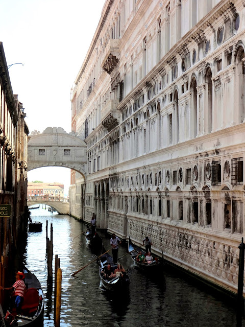 Gondolas passing under the Bridge of Sighs in Venice, Italy