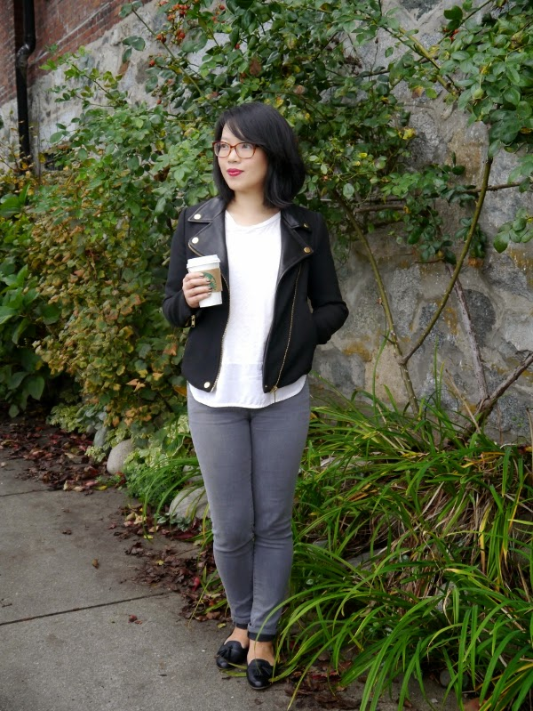 Black moto jacket and grey skinny jeans