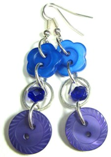 Earrings have small beads in silver rings hanging between flower buttons and fashion buttons