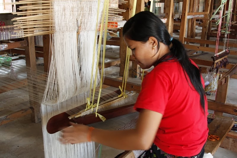 The painstaking work to prepare the yarns and set up the loom means much of the work is already done when the weaver sits at her loom.