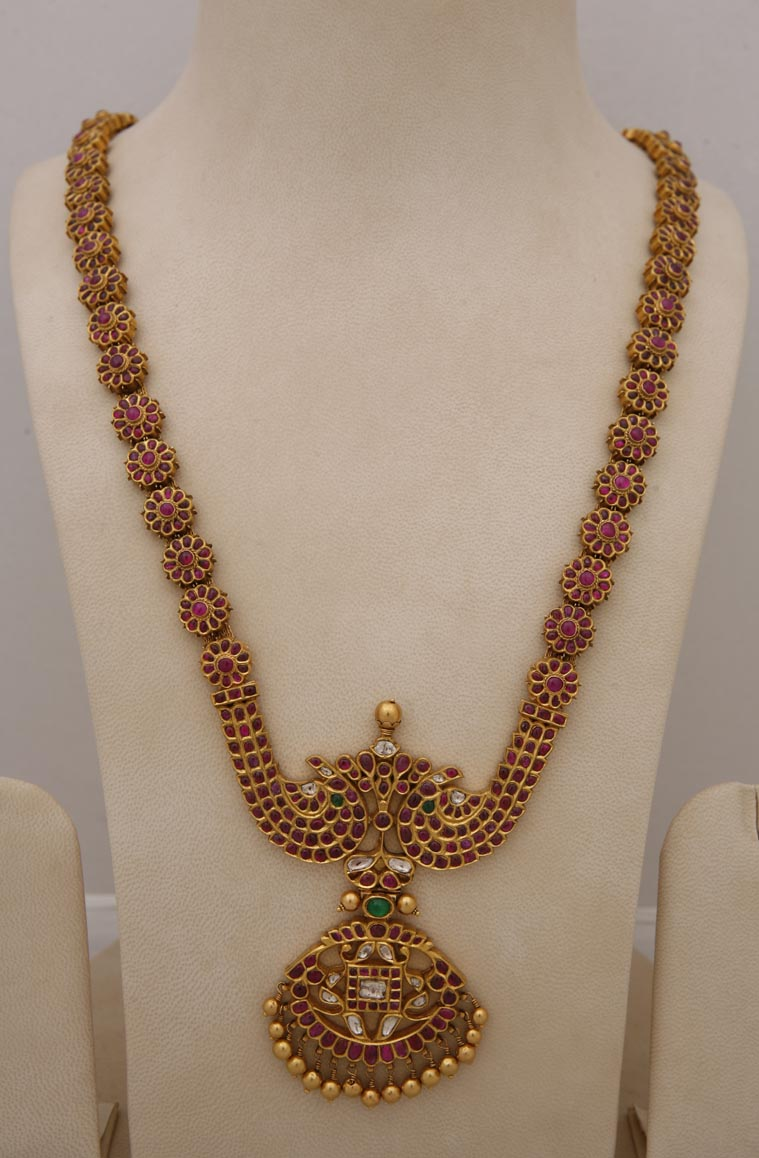 Antique ruby long haram from Tibarumals gems and jewels...