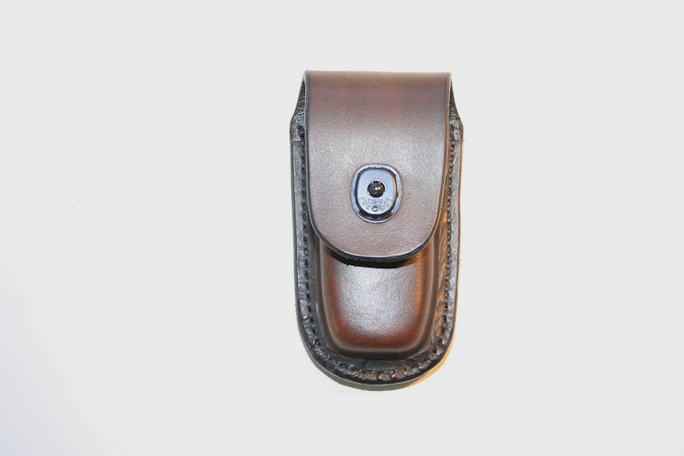 Leatherman pouch with 'lift the dot' fastener