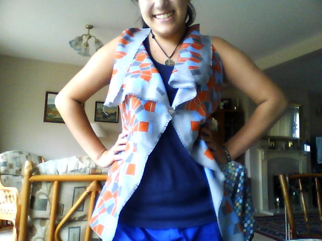 Daniella from Mississippi made her own Scarf Vest the fleur de lis brooch