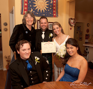 Signing of marriage documents complete:  Colin, Megan, best man, maid of honor and Patricia Stimac, Seattle Wedding Officiant