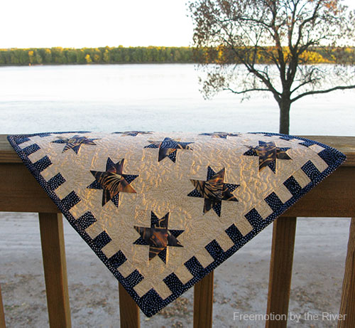 Quilt hanging on the deck at Freemotion by the River