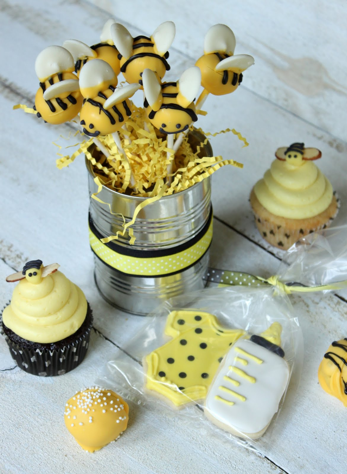 The Bee Cupcake Toppers Were Made From Yellow Fondant Rolled Into An Oval With Two Slivered Almonds Poked Sides Stripes And Eyes Piped On