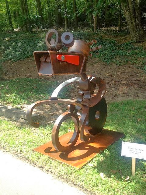 Cyclist Eats Mail Sculptural mailbox by Stefan Bonitz