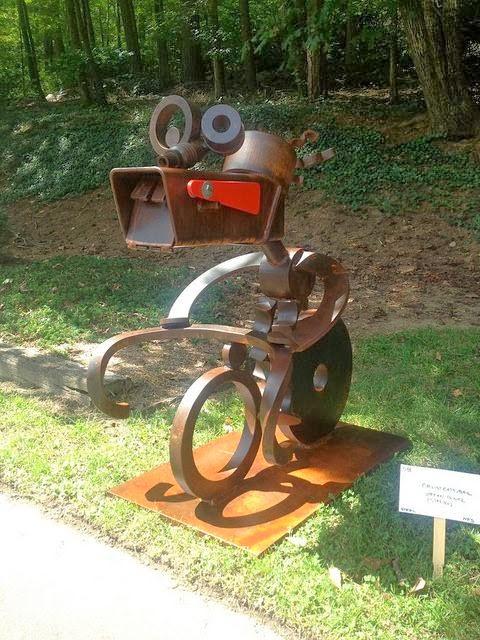 Cyclist Eats Mail Sculptural mailbox by Stefan Bonitz