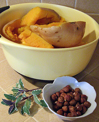Bowl of roasted butternut, sage leaves, and hazelnuts