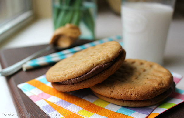 Peanut butter perfection! These Peanut Butter Cup Sandwiches combine two favorites... candy and cookies.