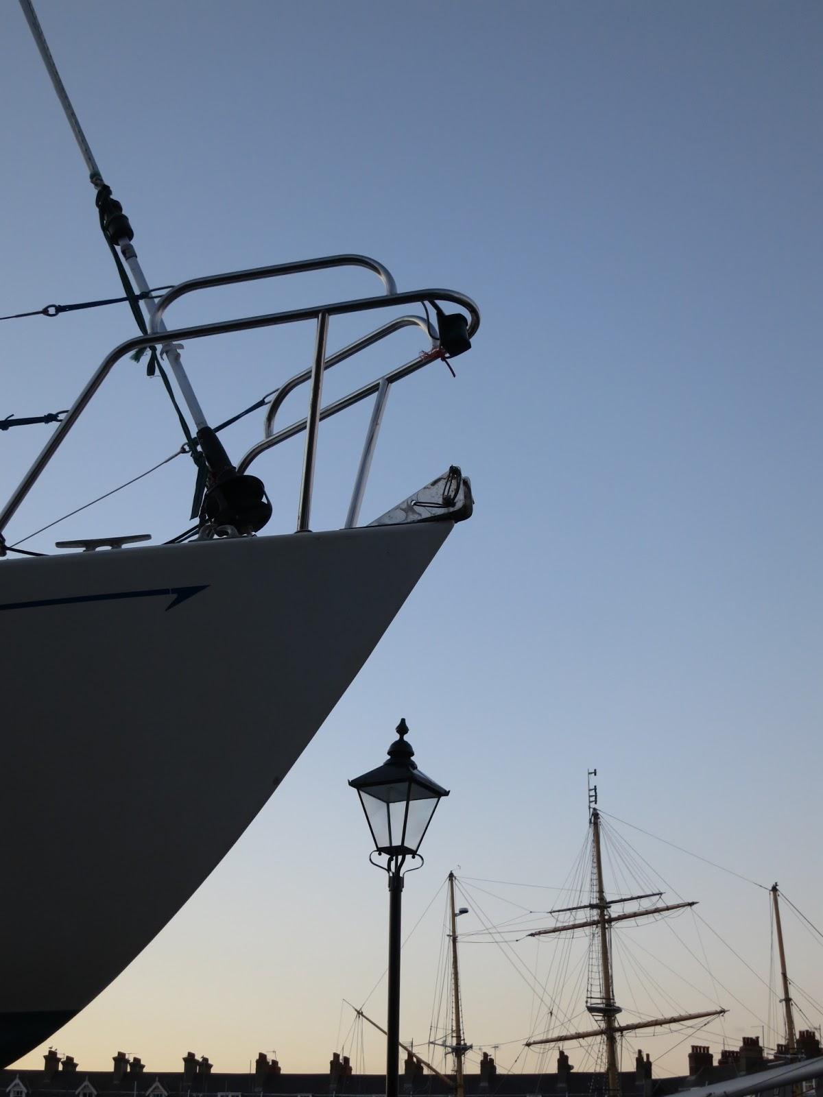 Boat, lampost, chimneys and tall ship masts.