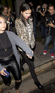 Selena Gomez in a leopard print blazer and leather trousers at 'Paper Towns' after party