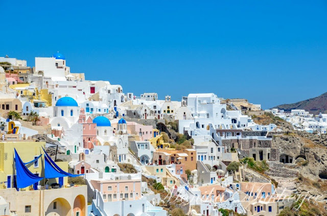 Blue Roofs in Oia Santorini Greece by Monika Mukherjee