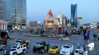 Chinggis Khaan Square in the evening. Toys for rent.