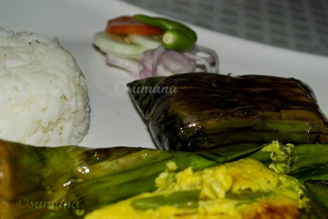 Bhetki macher paturi, baked fish wrapped in banana leaf