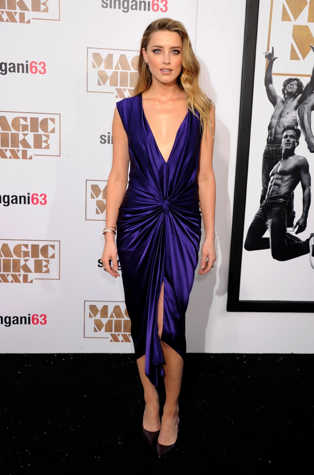 Amber Heard shows off skin in a plunging outfit at the 'Magic Mike XXL' LA premiere