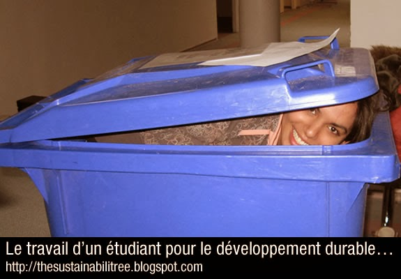 a student pops her head out of a recycling bin