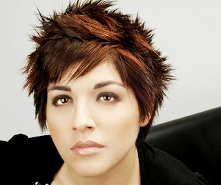 short spiky hairstyle with brown highlights