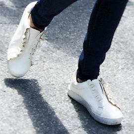 Tory Sport Ruffle Snow White sneaker.