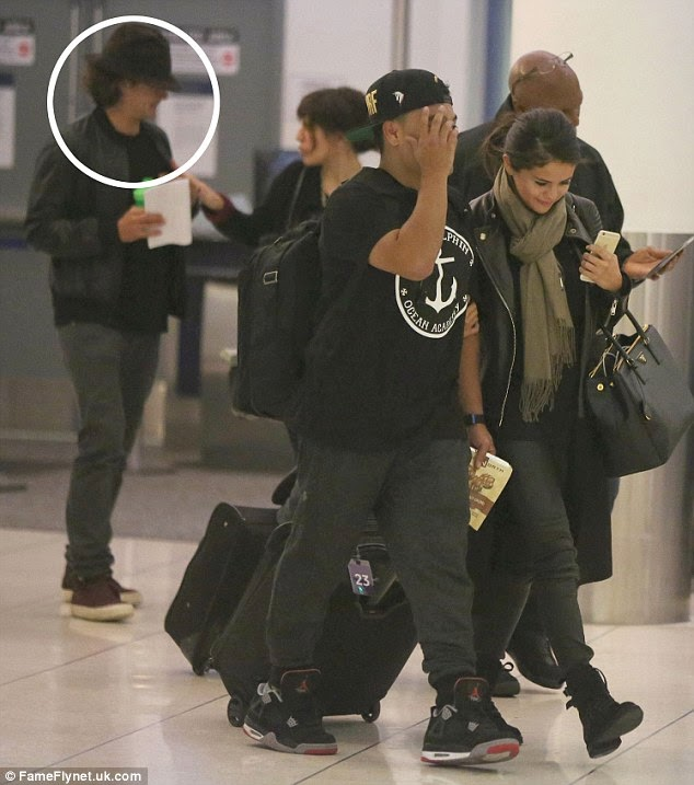 Selena Gomez and Orlando Bloom attempt to go incognito at LAX Airport