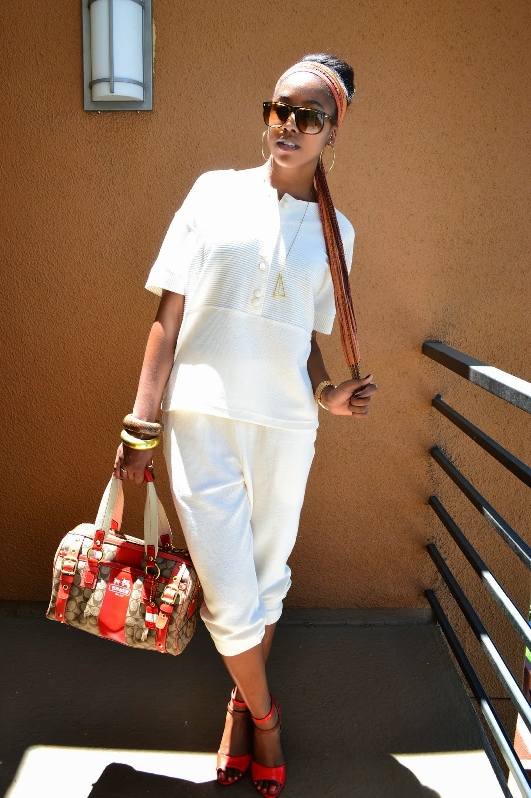 Wearing thrifted pant suit Coach handbag Jessica Simpson heels with Ray Ban sunglasses Topshop necklace and Nixon watch