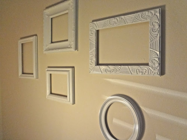 five empty picture frames used as wall art