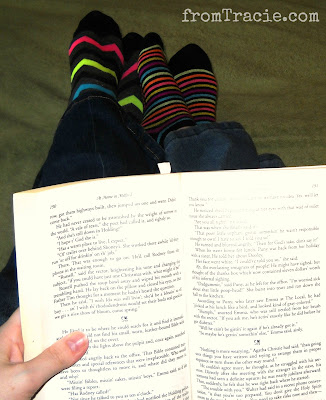 Reading A Book With Striped Socks