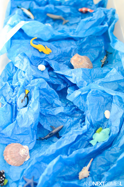 Ocean sensory bin with tissue paper for toddlers and preschoolers from And Next Comes L